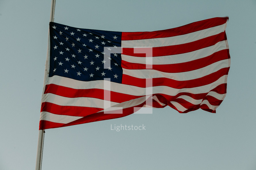 American flag on a flag pole in the sky