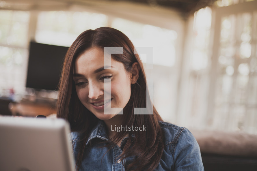 Smiling woman with a laptop computer.