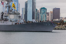 Navy Ship entering bay with city skyline in background San Diego men lining deck shipmate homecoming