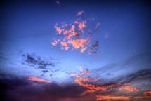 pink clouds in a cobalt blue sky