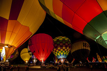 hot air balloon festival in the desert at night