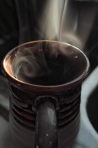 steam from a cup of coffee