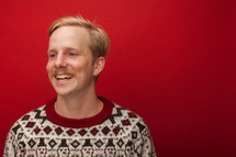 a man with a mustache in Christmas sweater