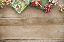 border of Christmas gifts on wood