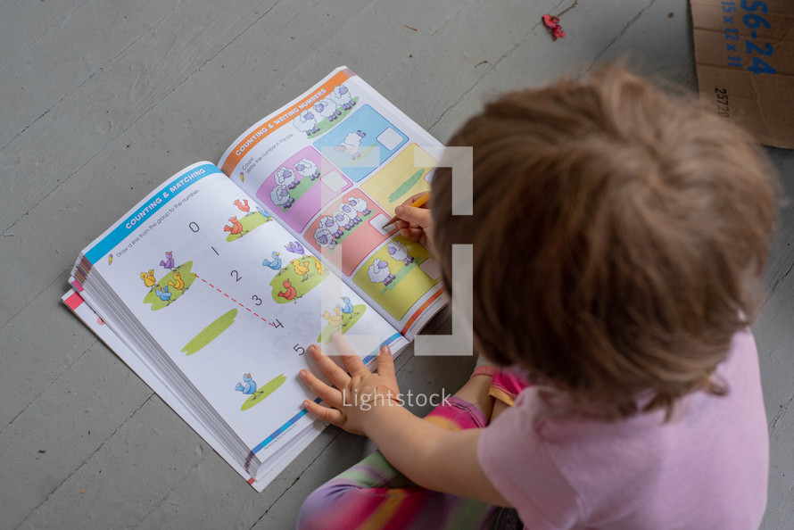 a toddler learning numbers
