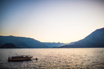 a boat on lake Como at sunset