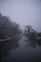 fog and frost along the shore of a lake