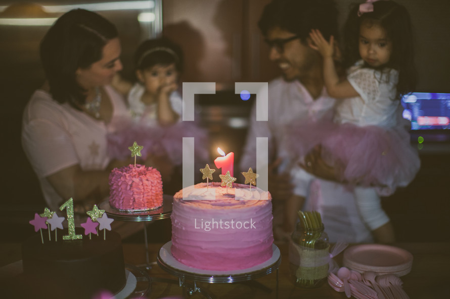 a family celebrating their daughter's first birthday