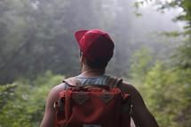 man hiking on a trail