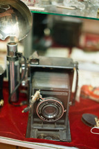 Antique display with a vintage camera.