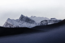 jagged snow capped mountains peaks
