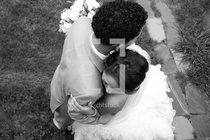 bride and groom hugging