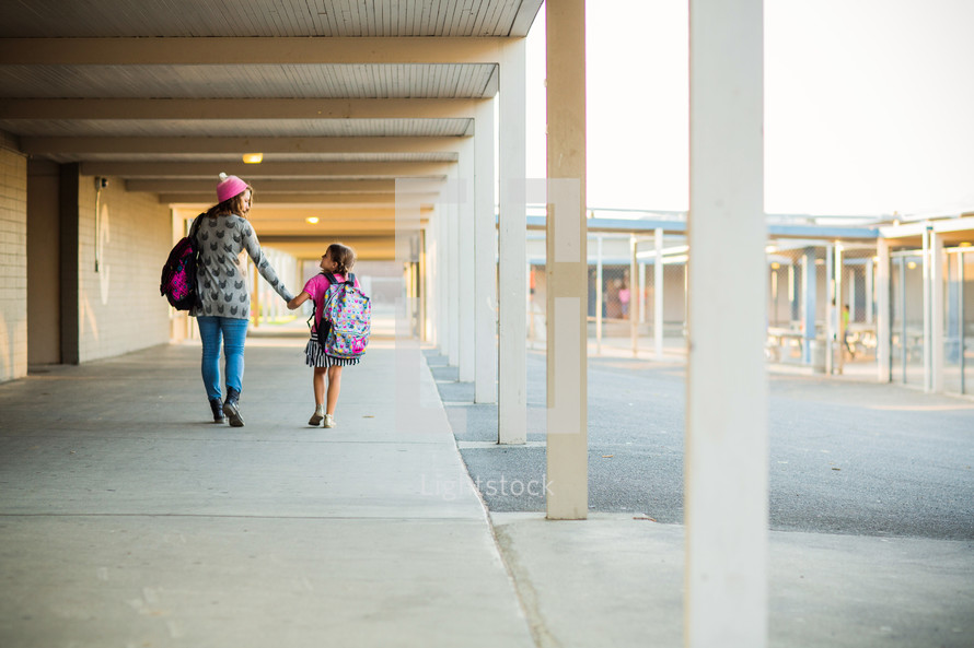 Back to school, sister walking little sister to school, holding hands, friends, relationship, school, campus, siblings, hallway