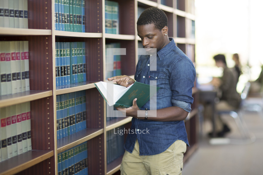 a man checking out books at a library