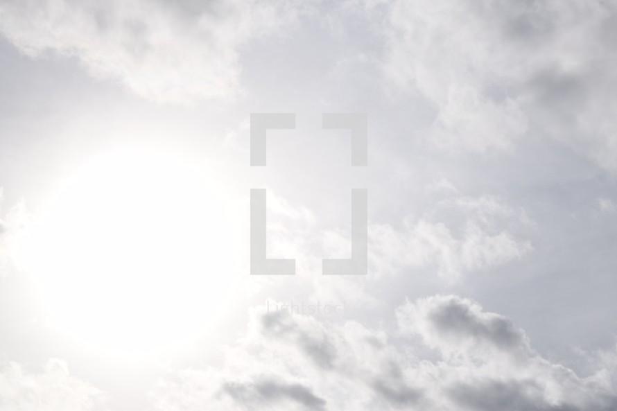glow of the sun in a cloudy sky