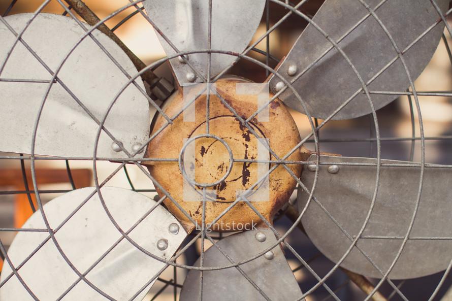 fan blades closeup on an old rusty fan