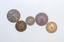 Several small metal clocks