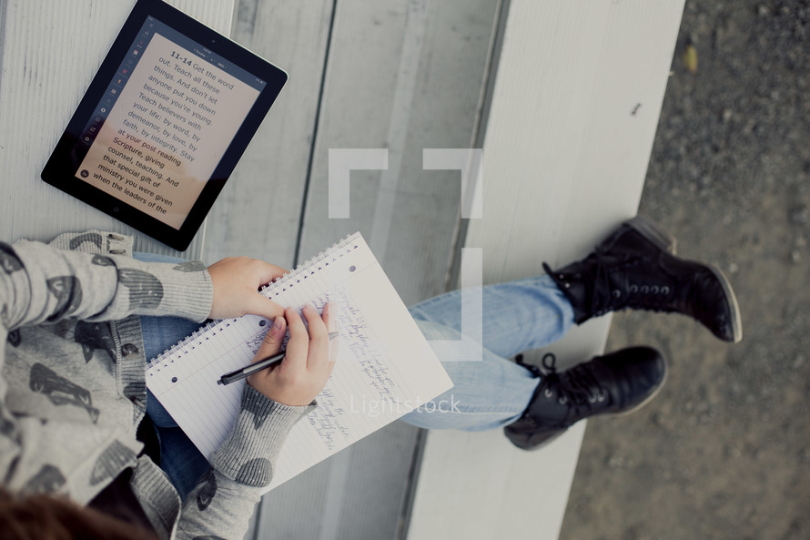 Teenage girl reading bible on an iPad,  1 Timothy 4:12,  bleachers, youth, student technology, study, devotional, writing Jeremiah 29:11 back to school