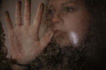 portrait of a woman through frosted glass