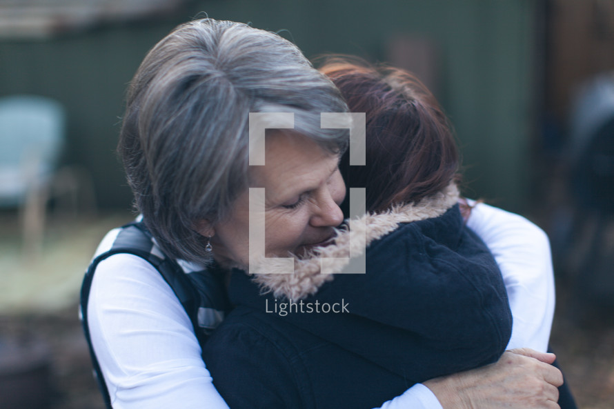 a mother and daughter hugging