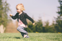 Girl running on the grass.