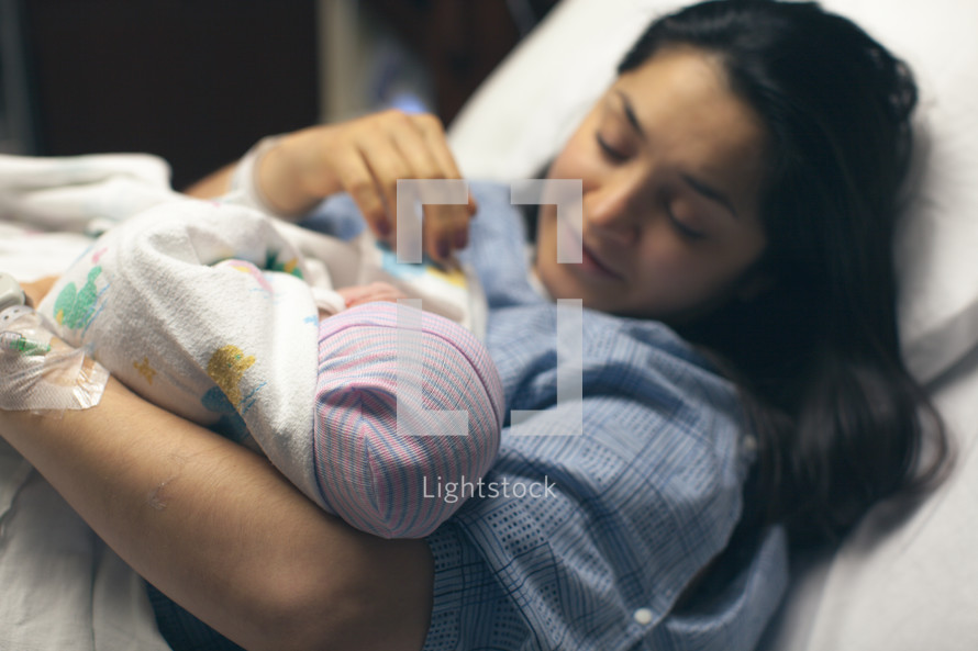 a new mother holding her newborn baby