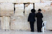Men worshipping at the Wailing Wall/Western Wall in Jerusalem.