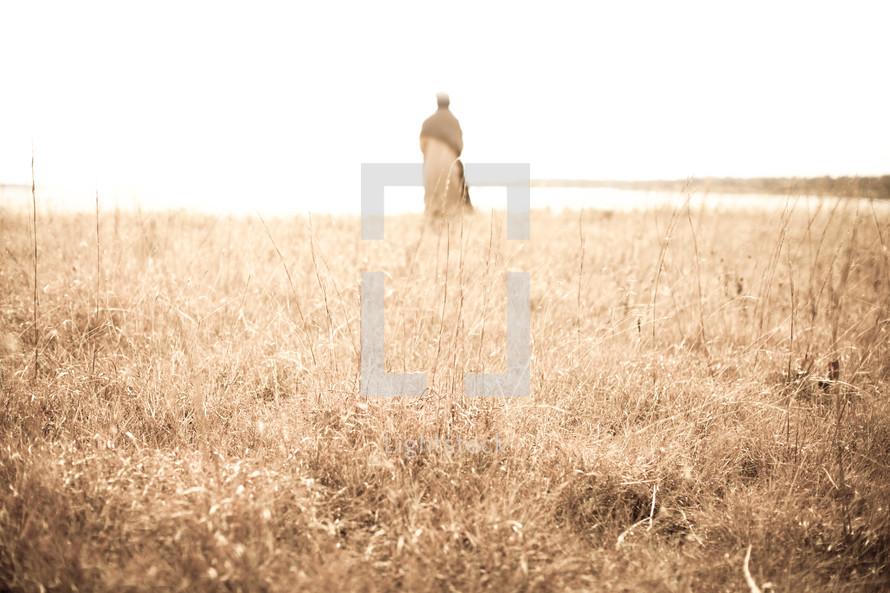 Joseph standing in a field under sunlight