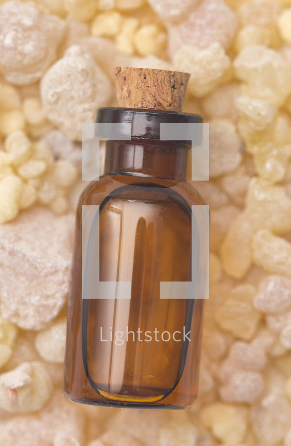Frankincense Essential Oil in a Rustic Corked Bottle