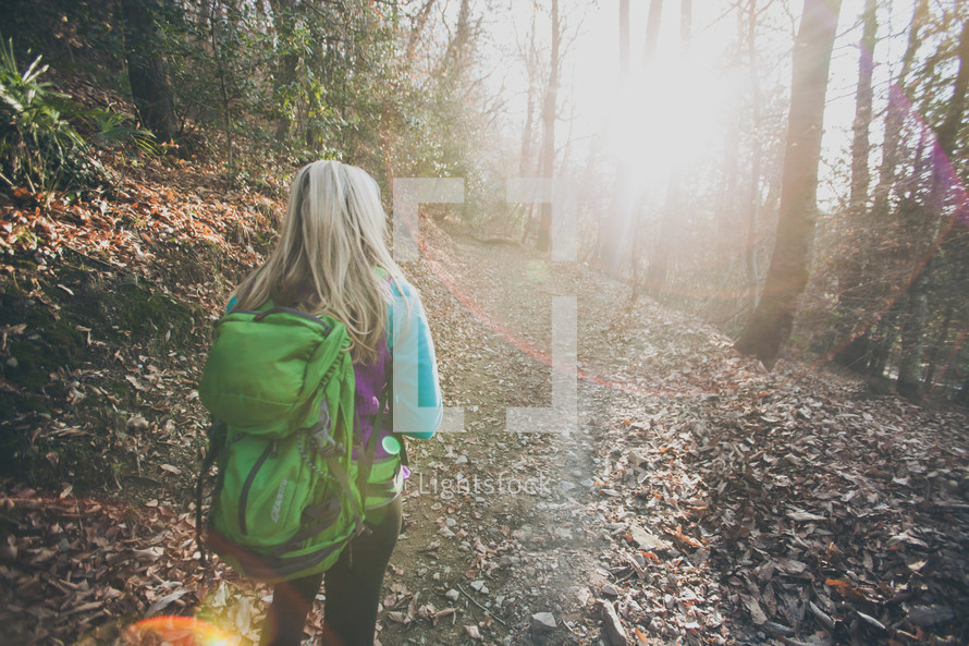 woman hiking on a nature trail