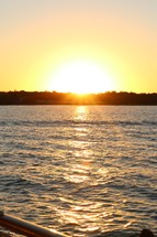 sunsetting over a lake