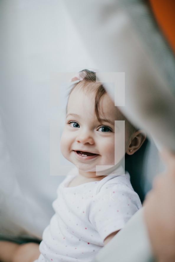 a smiling toddler girl
