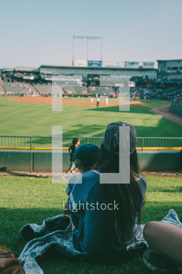 mother and son watching a baseball game