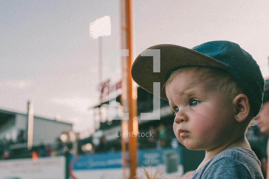 toddler watching a baseball game