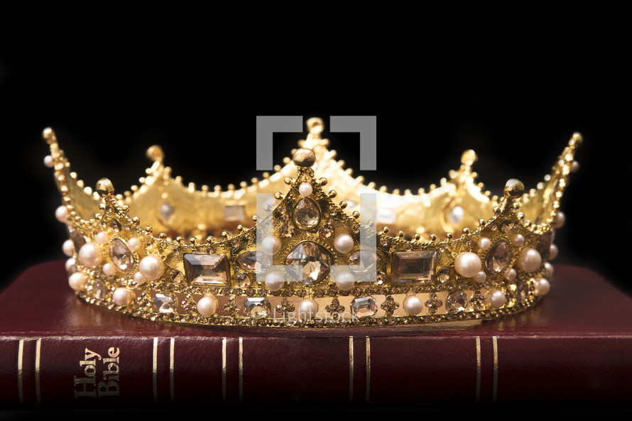 crown on a Bible on black