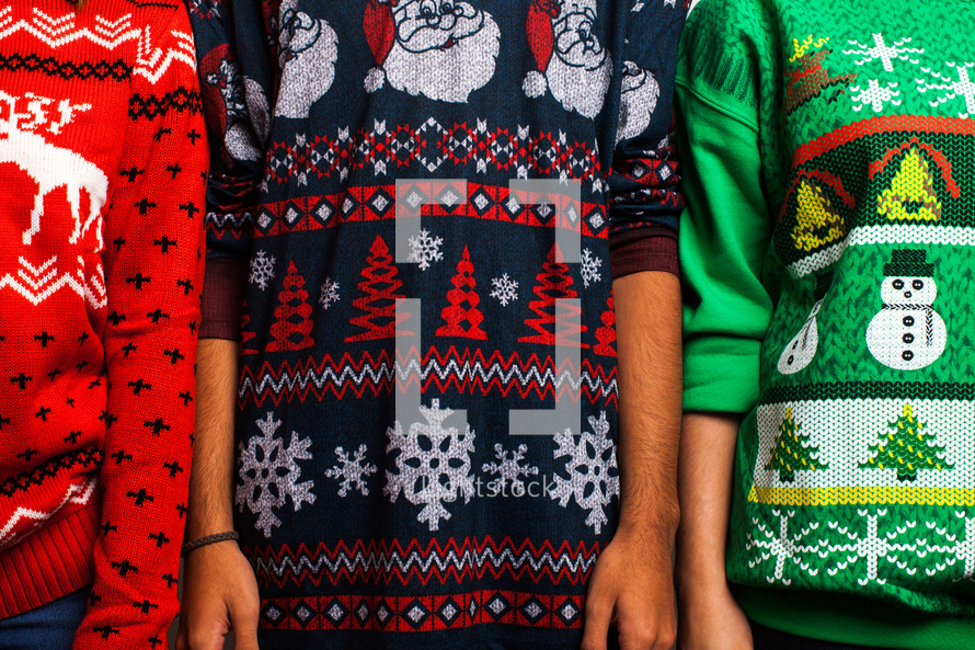 torsos in ugly Christmas sweaters