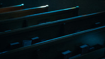 pews in a church at night