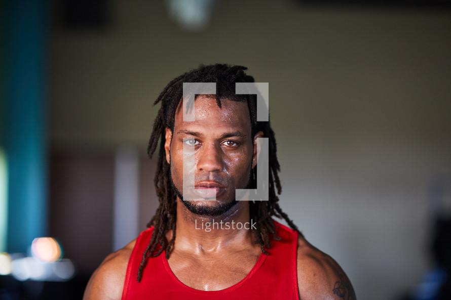 head shot of a sweaty man after a workout.