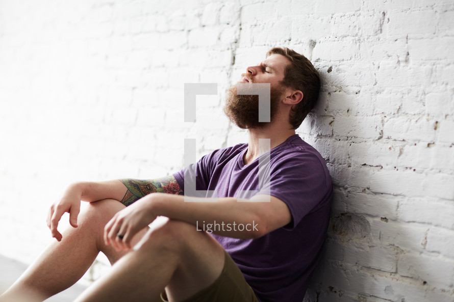 a stressed man sitting alone