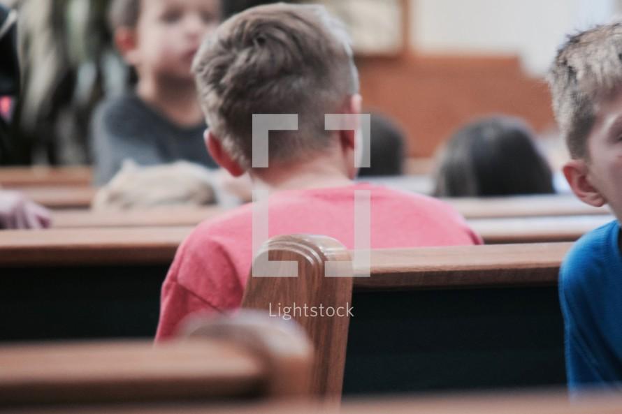 children sitting in church pews