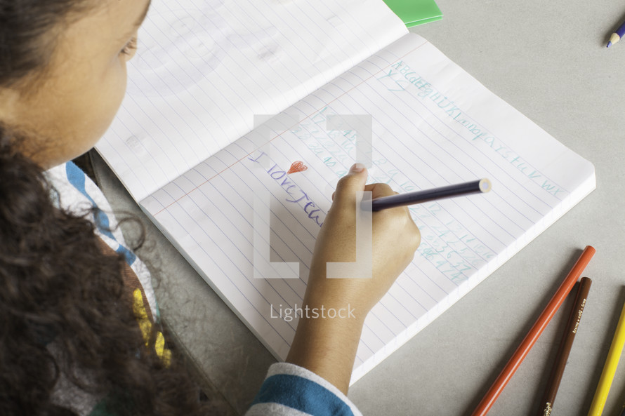 a girl child writing a letter to Jesus
