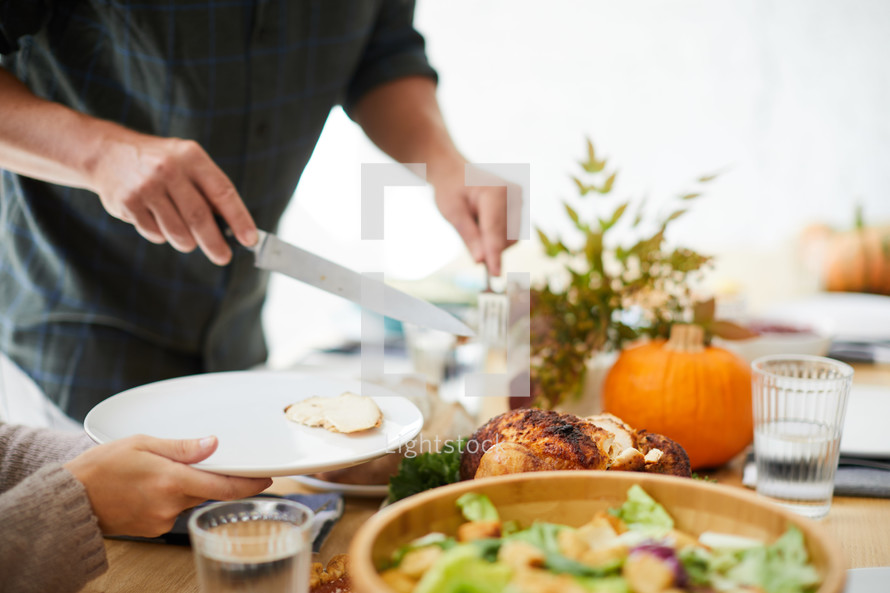 carving a turkey at Thanksgiving