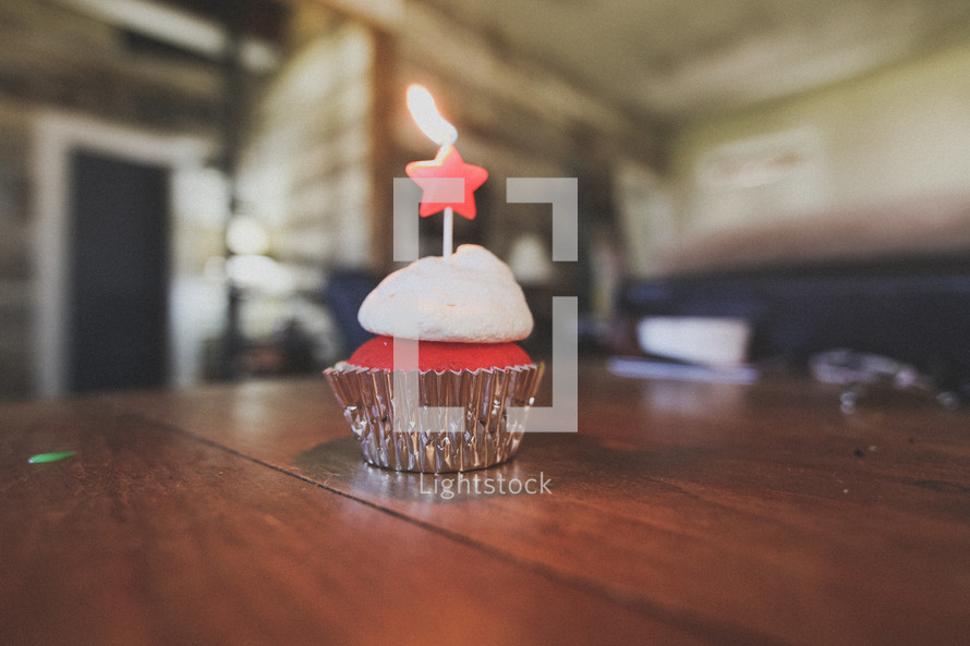 A birthday cupcake with a star on top