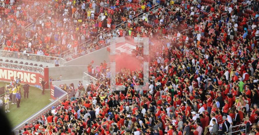 a crowded sports stadium