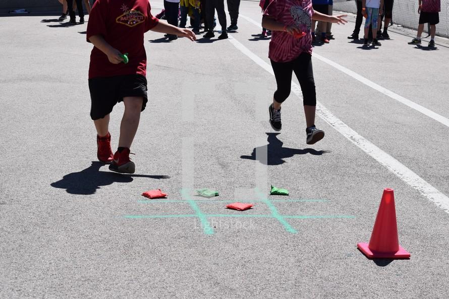 kids playing bean bag tic-tac-toe