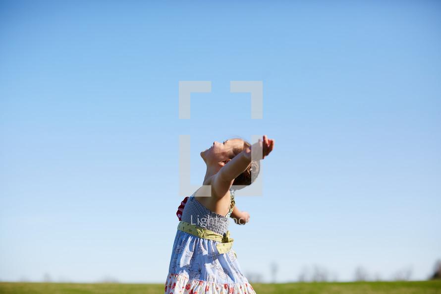 a girl dancing in a field