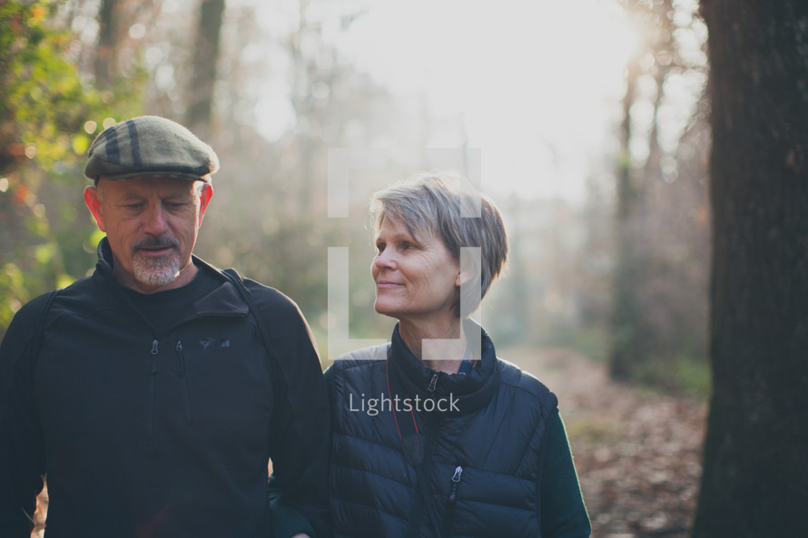 couple walking together on a nature trail