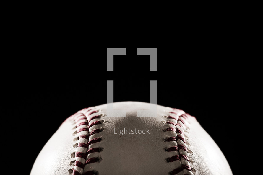 a baseball against a black background