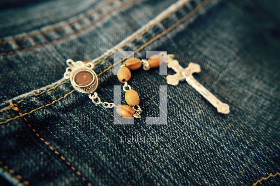 rosary with soil from Jerusalem in a jeans pocket