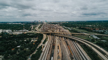 aerial view over highway overpasses and train tracks in a city